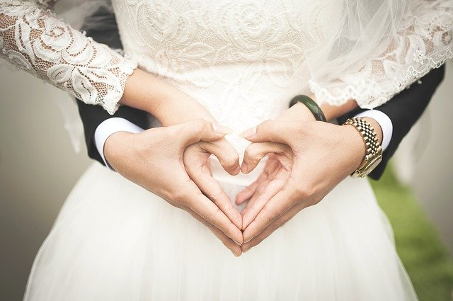 hands in marriage shaping a heart