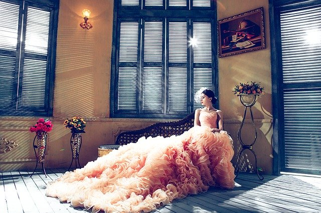 beautiful long wedding dress in a room of many windows